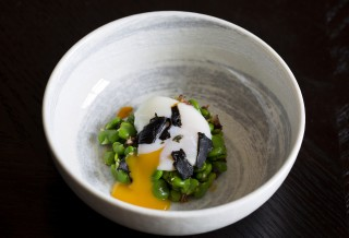 Slow-cooked egg with broad beans, garlic and Iberico ham dressing at aqua nueva