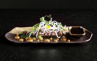 wagyu beef, red wine teriyaki, onion miso, rice nest, herbs