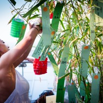 Tying wishes to the traditional Tanabata tree