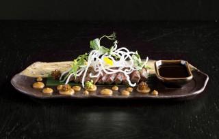 wagyu beef, red wine teriyaki, onion miso, rice nest, herbs
